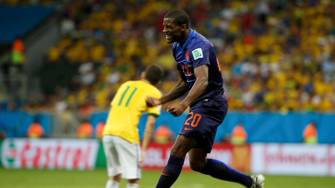 Georginio Wijnaldum of the Netherlands celebrates after scoring a goal during the 2014 World Cup third-place playoff between Brazil and the Netherlands at the Brasilia national stadium in Brasilia July 12, 2014. (Reute
