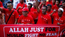 In Malaysia, Islam's legal advance divides families and nation