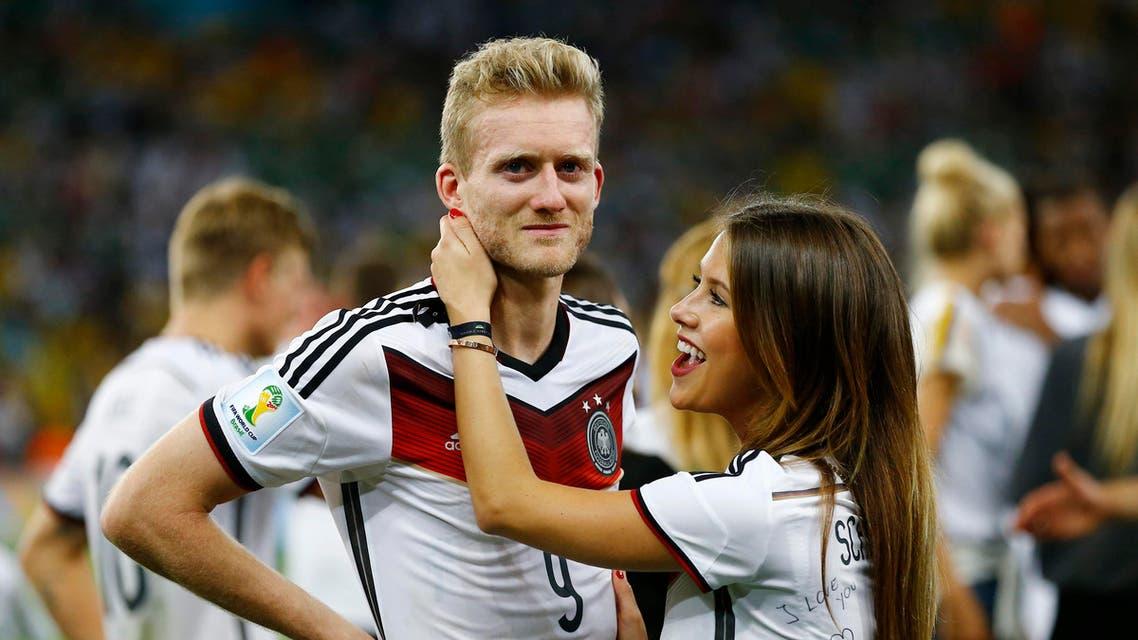 Germany's WAGS cheer, Merkel joins team for a selfie