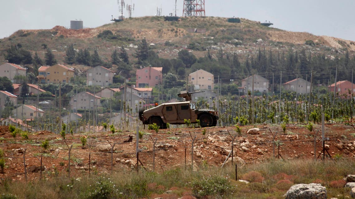 Israeli soldiers patrol near the Lebanese-Israeli border as seen from the southern Lebanese village of Mays Al-Jabal, near the border with Israel, June 7, 2014. Reuters