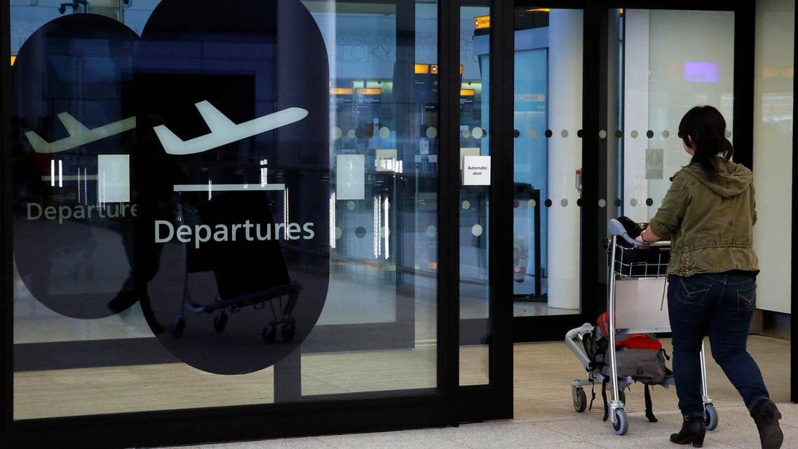 A passenger enters departures in Terminal 2 at Heathrow Airport in London July 3, 2014. (Reuters)