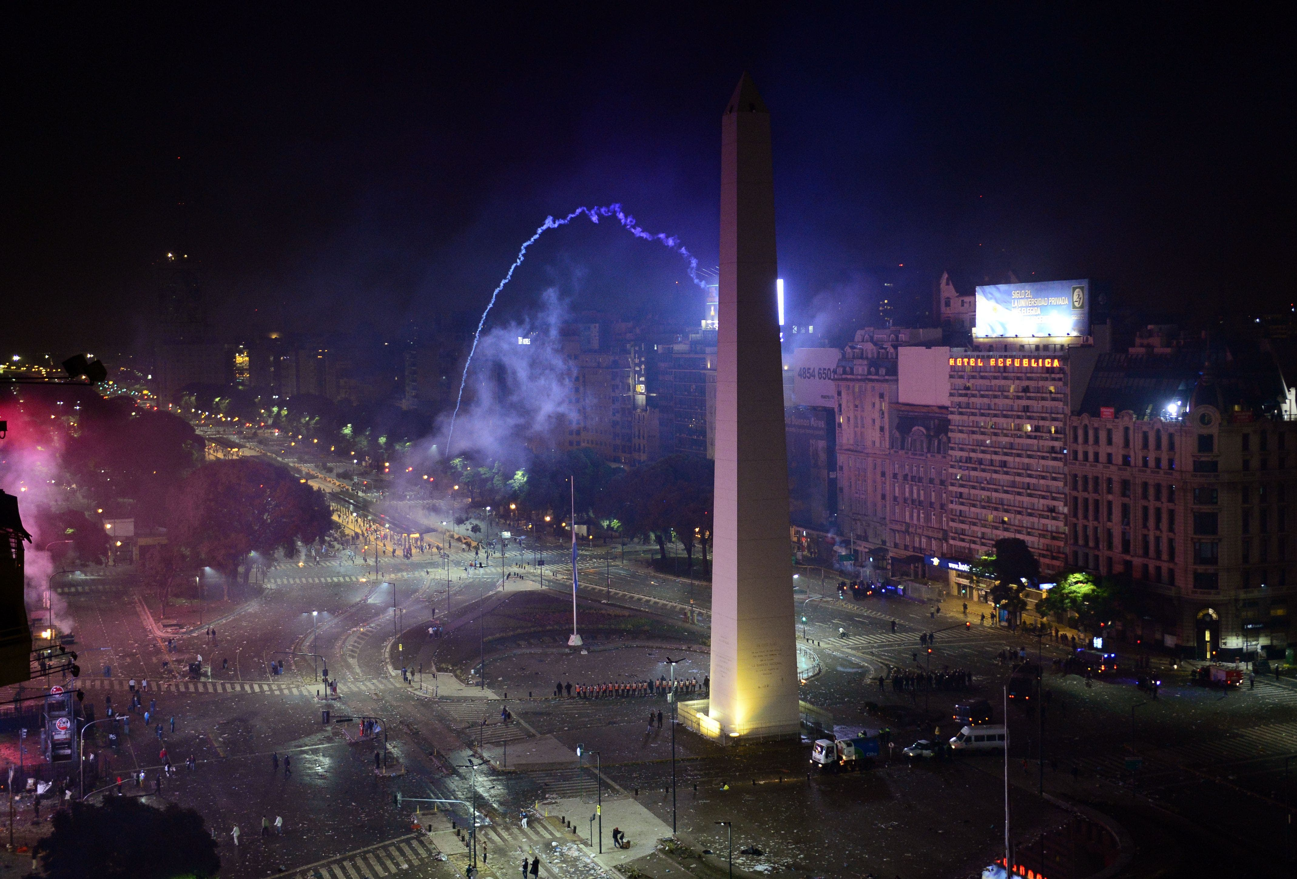 ear gas falls on 9 de Julio Avenue during disturbances following celebrations for the performance of the national team in the FIFA World Cup Brazil 2014 final at the Obelisk in Buenos Aires on July 13, 2014. (AFP)