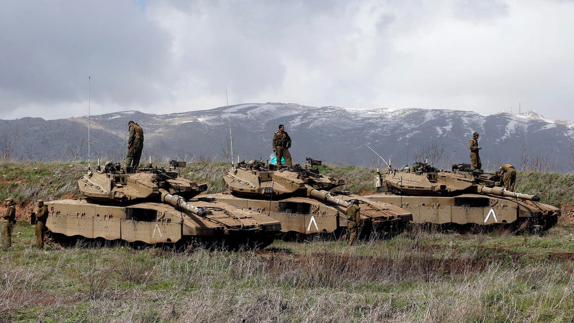 Israeli soldiers stand atop tanks in the Golan Heights near Israel's border with Syria March 19, 2014. (Reuters)