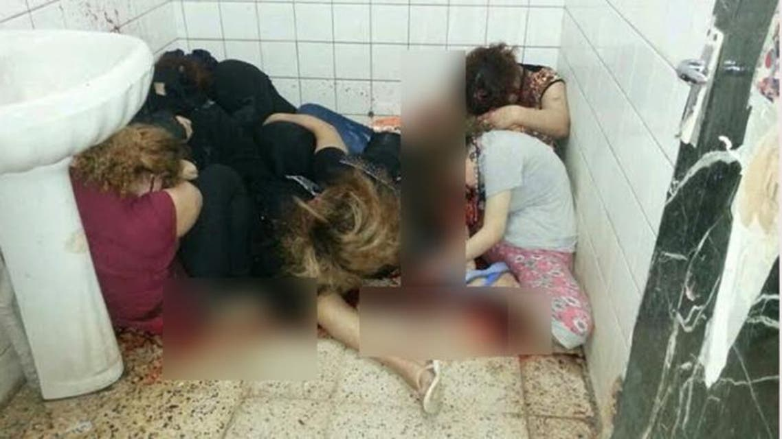 the bodies of alleged prostitutes lying on the floor of an apartment in the Iraqi capital's Zayouna district. (AFP)