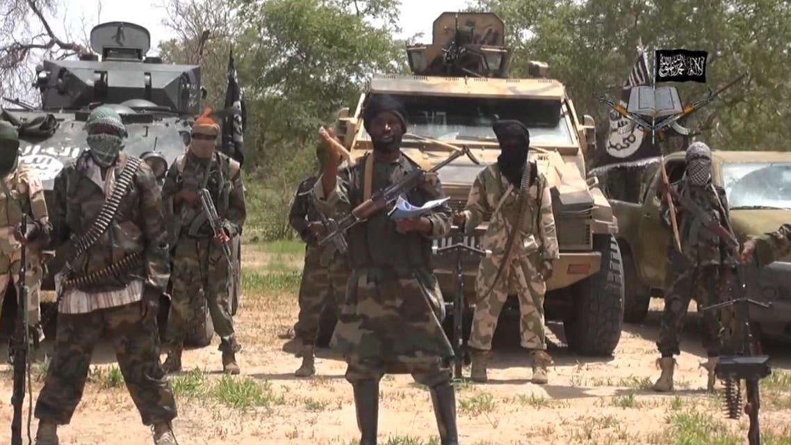 leader of the Nigerian Islamist extremist group Boko Haram, Abubakar Shekau (C). (AFP)