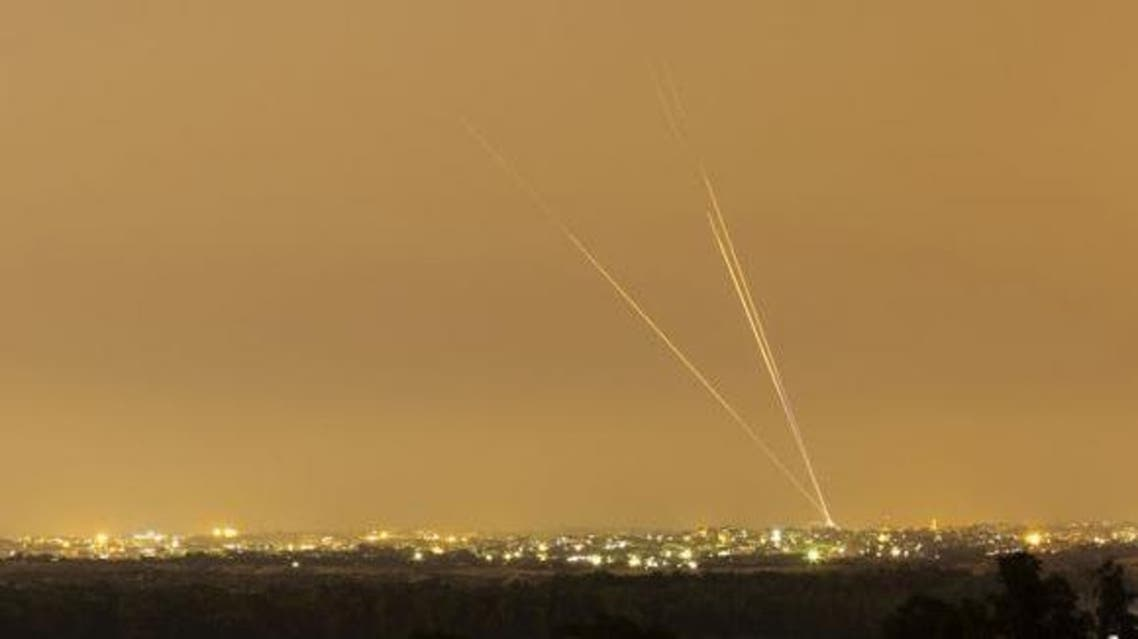 Smoke trails are seen as rockets are launched towards Israel from the northern Gaza Strip July 12, 2014.