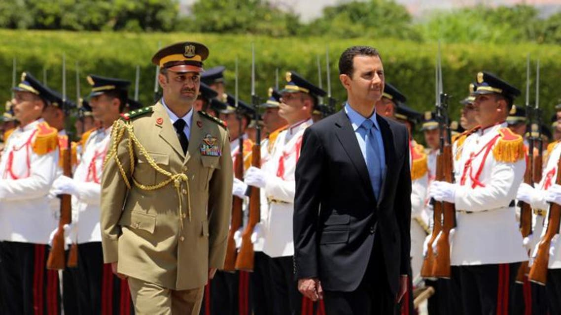 yrian President Bashar al-Assad (C) reviewing the honor guard, ahead of being sworn in for a new seven-year term. (Reuters)