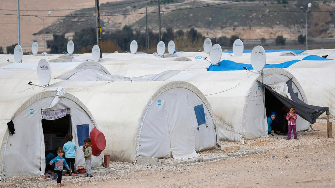 Syrian refugee children play outside their tents at a refugee camp in Nizip in Gaziantep province, near the Turkish-Syrian border (Reuters)