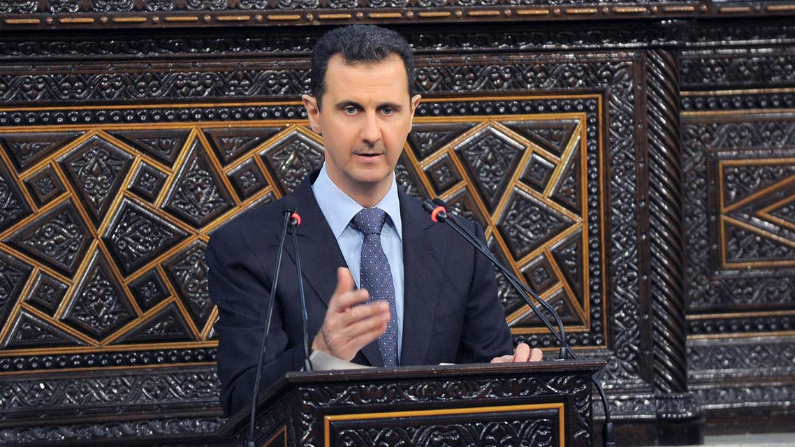 Syria's President Bashar al-Assad delivers a speech to Syria's parliament in Damascus, June 3, 2012,