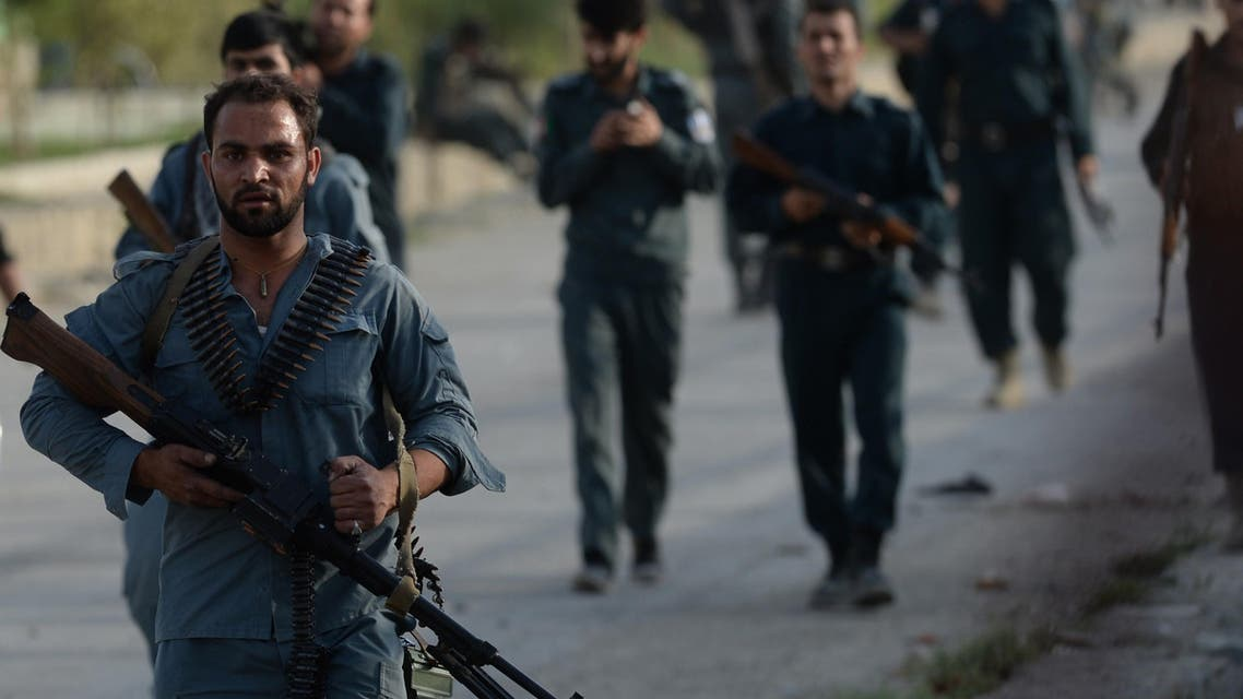 fghan policemen arrive at the site of a suicide attack in front of Kabul's military airport on July 17, 2014. AFP