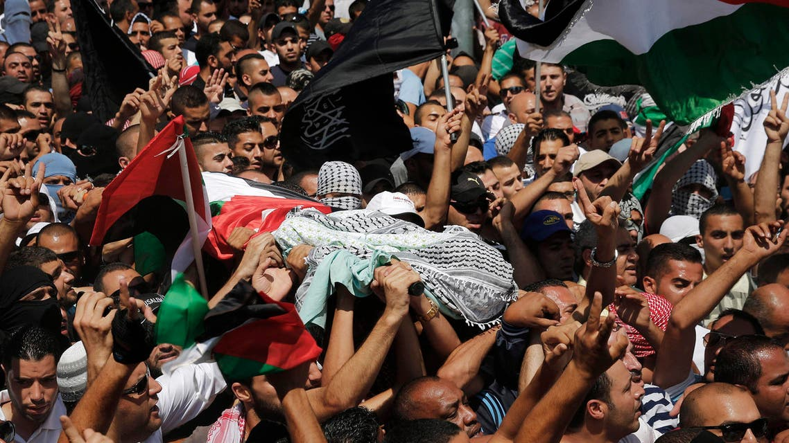Palestinians carry the body of 16-year-old Mohammed Abu Khudair during his funeral in Shuafat, an Arab suburb of Jerusalem July 4, 2014.