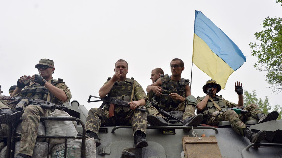 Ukrainian soldiers sit atop an armored personnel carrier (APC) as they travel near the eastern Ukrainian city of Slavyansk on July 18, 2014. (AFP)