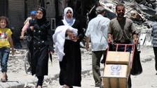 U.N. delivers first aid to besieged Syria town since 2012