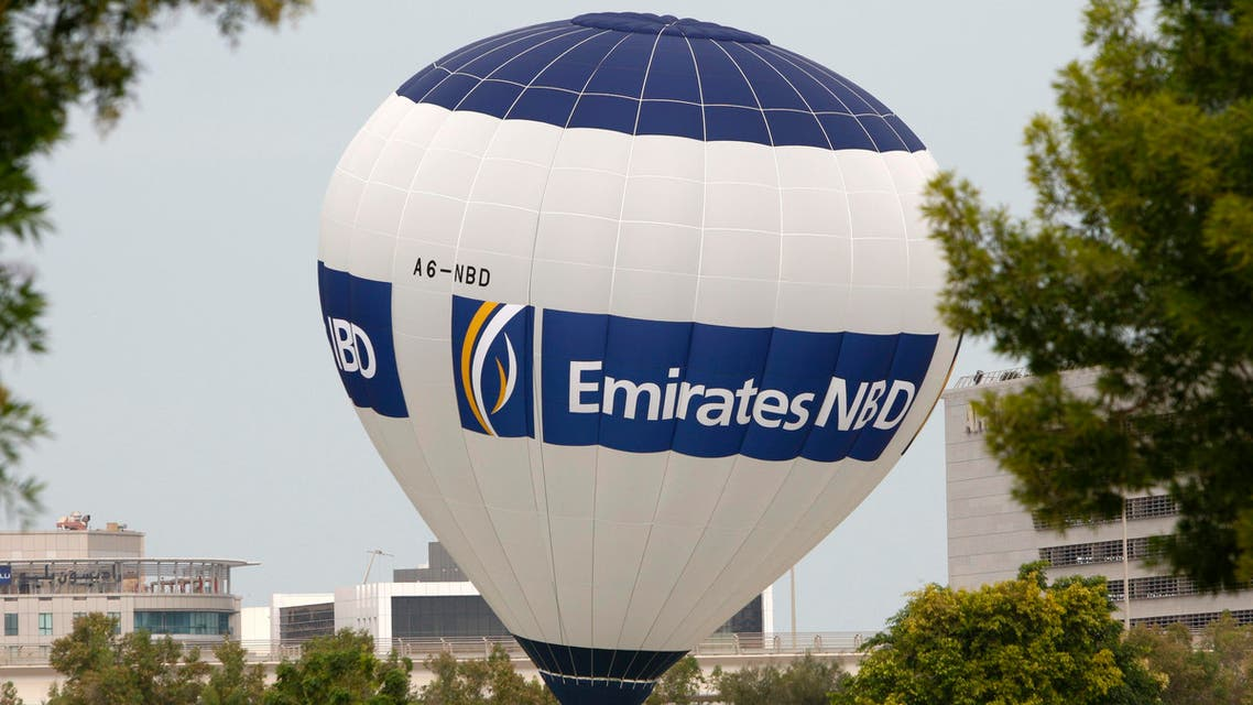 A hot air balloon bearing the logo of Emirates NBD bank hovers over the Emirates Golf Course in Dubai. (Reuters)