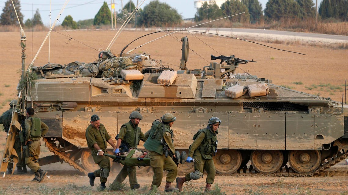 Israeli soldiers carry a comrade on a stretcher, who was wounded during an offensive in Gaza, outside northern Gaza July 20, 2014.