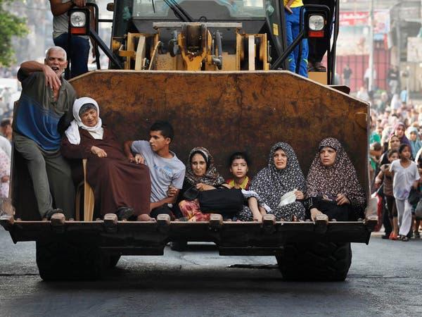 غزة: الآلاف يفرون من حي الشجاعية والجثث في الشوارع