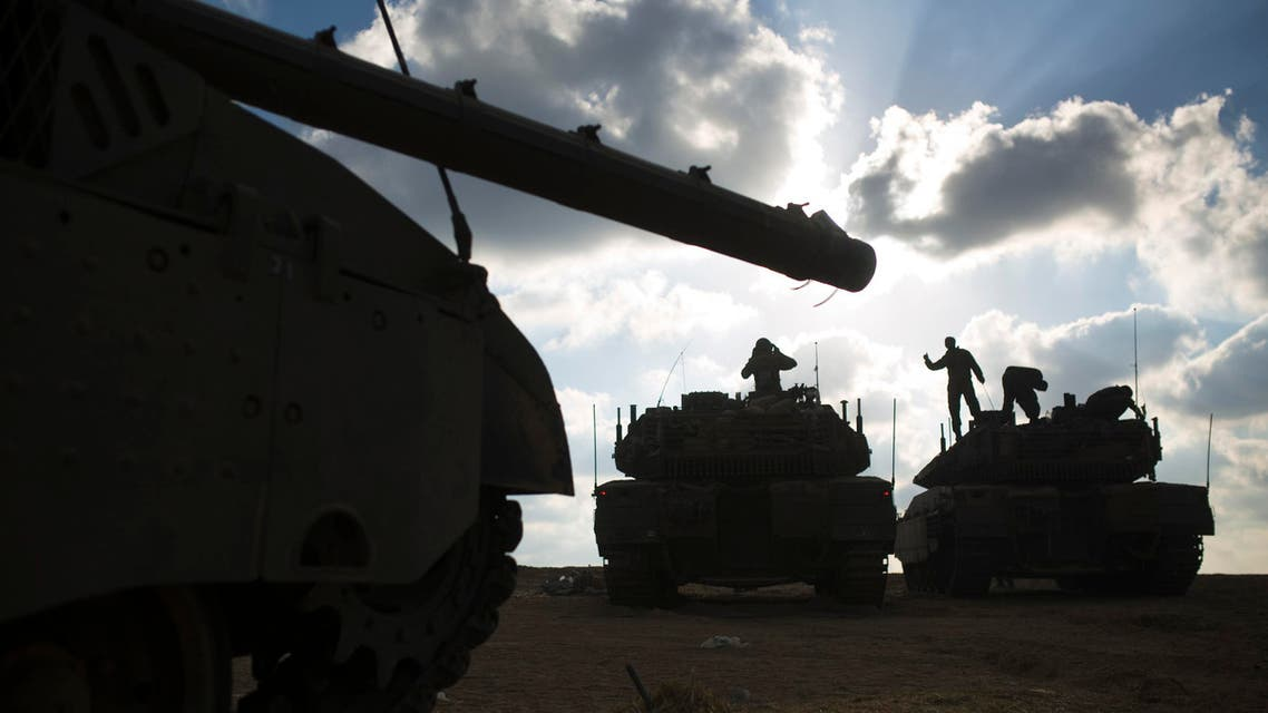 Israeli soldiers stand atop tanks outside central Gaza Strip July 19, 2014. (Reuters)