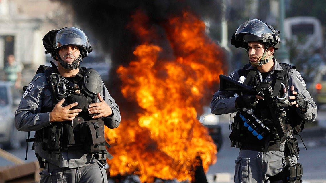Israeli police officers stand guard during a protest by Israeli Arabs in the northern city of Nazareth, against Israel's offensive in the Gaza Strip July 21, 2014. (Reuters)
