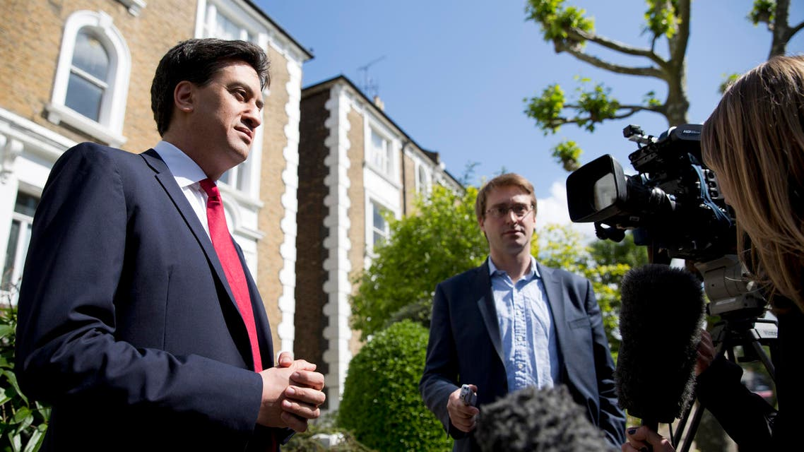 Britain's leader of the opposition Labour Party Ed Miliband (L) speaks to the media outside his home, following nationwide local election results, in London May 23, 2014.