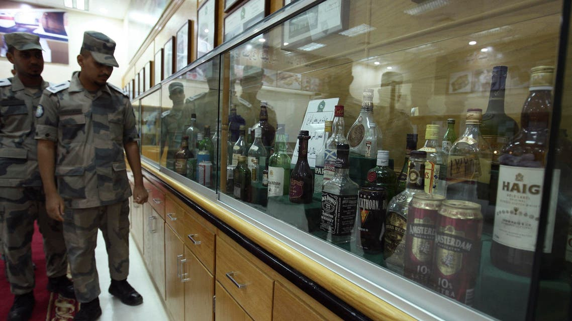 Students under training in the Drug and Poison Division of King Fahad Security College look at a collection of bottles of alcohol that Saudi security forces confiscated in the past, in Riyadh May 19, 2009. (Reuters)