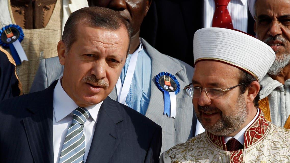 Turkey's Prime Minister Tayyip Erdogan chats with Head of Turkey's Religious Affairs Directorate Mehmet Gormez. (Reuters)