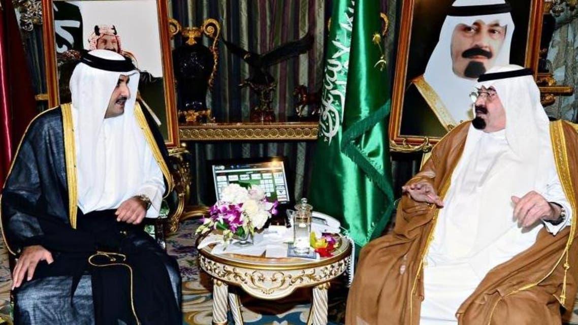 الملك وأمير قطر