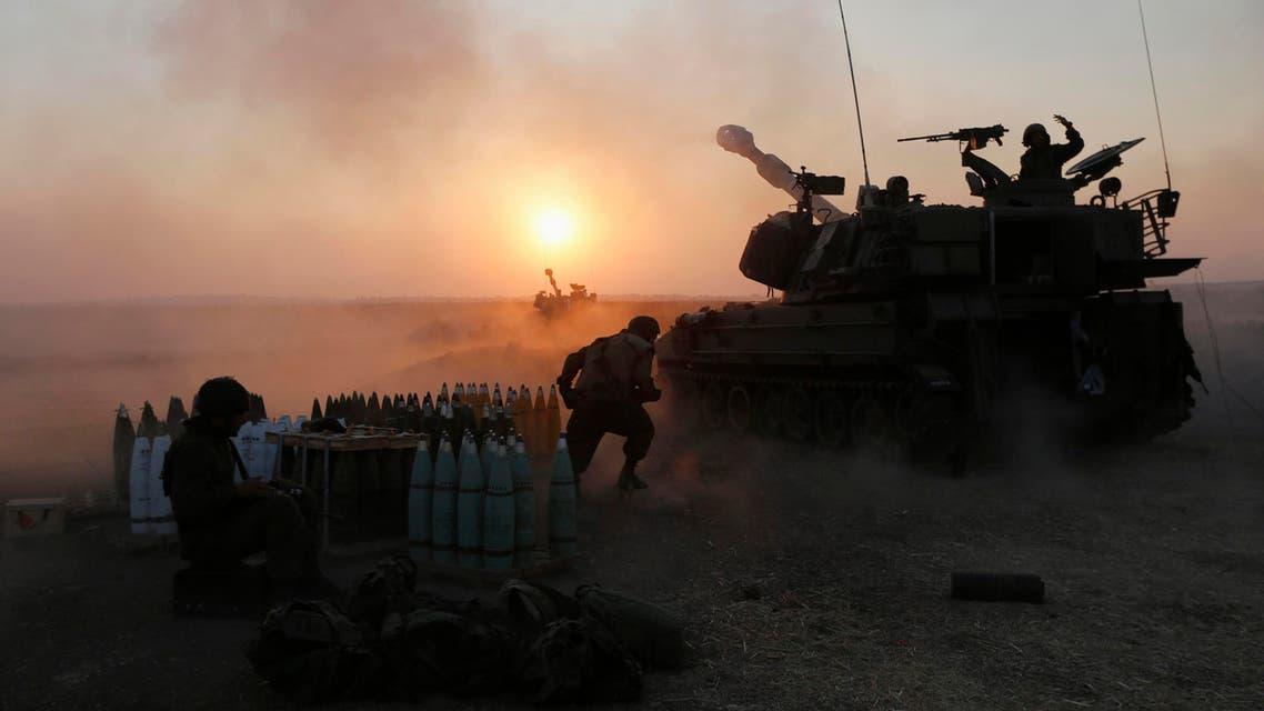 An Israeli mobile artillery unit fires towards the Gaza Strip July 21, 2014. reuters