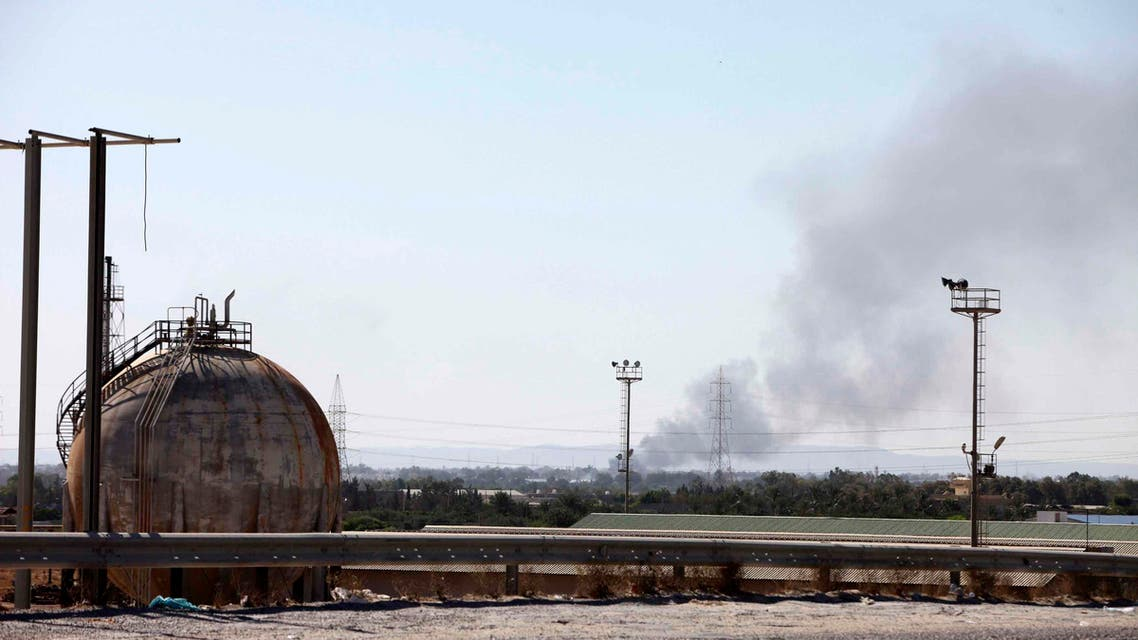 Smoke rises near oil tanks after heavy fighting between rival militias broke out near the airport in Tripoli July 23, 2014. Reuters