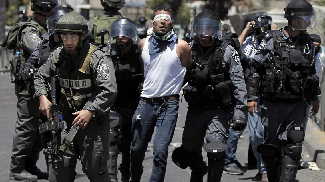 Israeli security forces arrest a Palestinian (C) during clashes following traditional Friday prayers near the Old City in East Jerusalem on July 25, 2014. (Reuters)