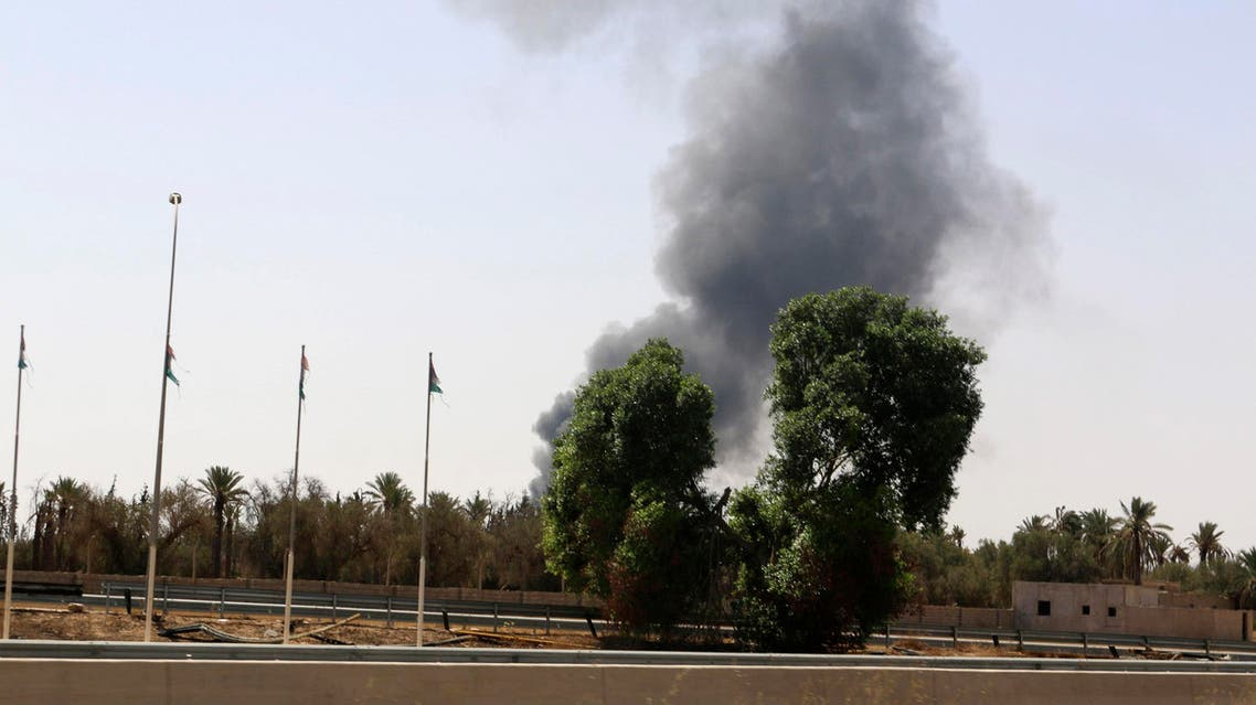 Smoke rises over the Airport Road area after heavy fighting between rival militias broke out near the airport in Tripoli July 25, 2014. (Reuters)