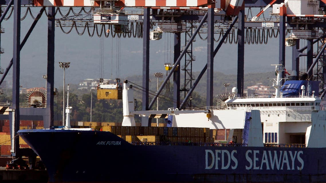 A container (top L) is moved from the Danish ship Ark Future, carrying a cargo of Syria's chemical weapons, after it arrived at Gioia Tauro port in southern Italy July 2, 2014.