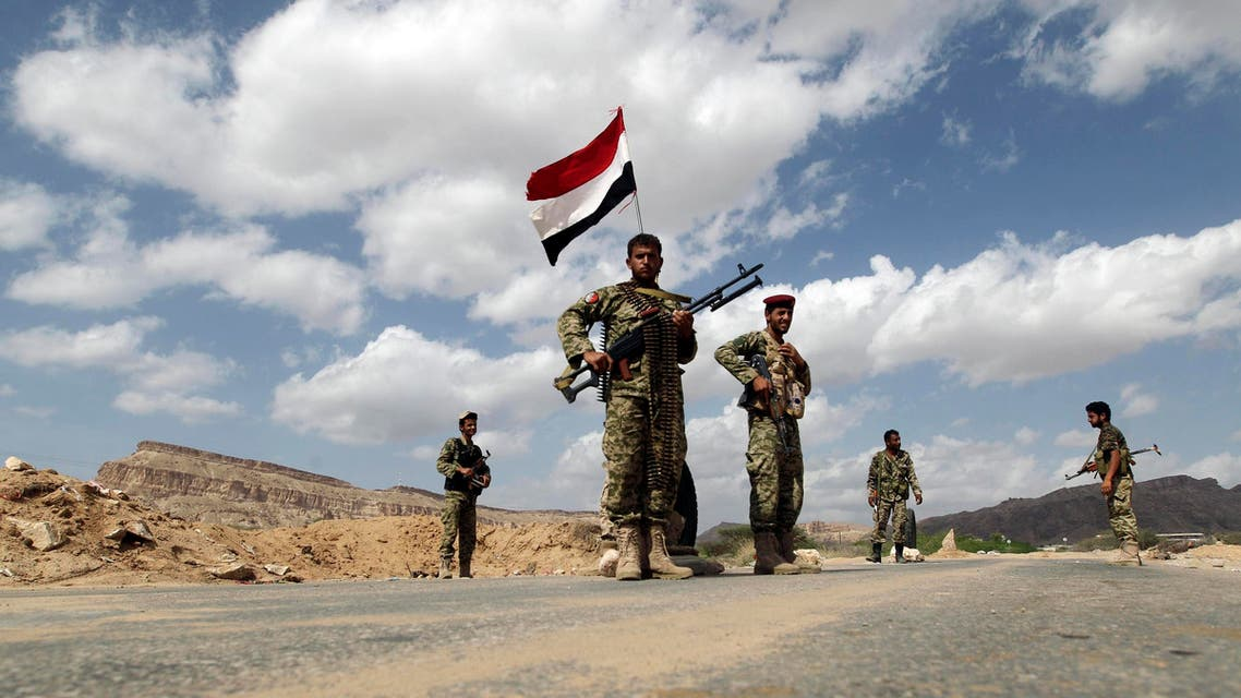 Yemeni soldiers man a checkpoint in al-Mahfad in the southern Yemeni province of Abyan May 23, 2014. Picture taken May 23, 2014. Reuters