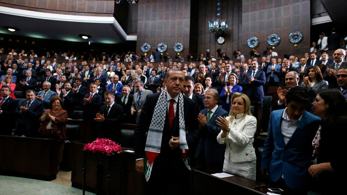Turkey's Prime Minister Tayyip Erdogan leaves his seat to address members of parliament from his ruling AK Party (AKP) during a meeting at the Turkish parliament in Ankara July 22, 2014. (Reuters)