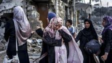Gazans dig dead from rubble in scenes of war devastation