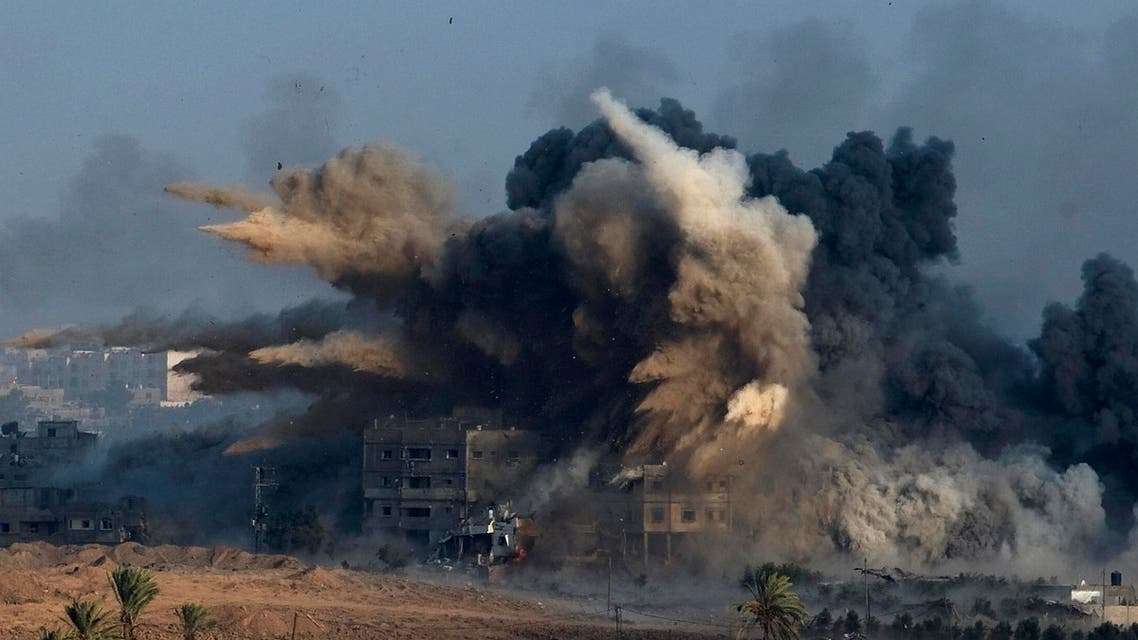 An explosion during an Israeli strike in the northern Gaza Strip is pictured from the Israeli border with Gaza, early morning July 26, 2014 Reuters