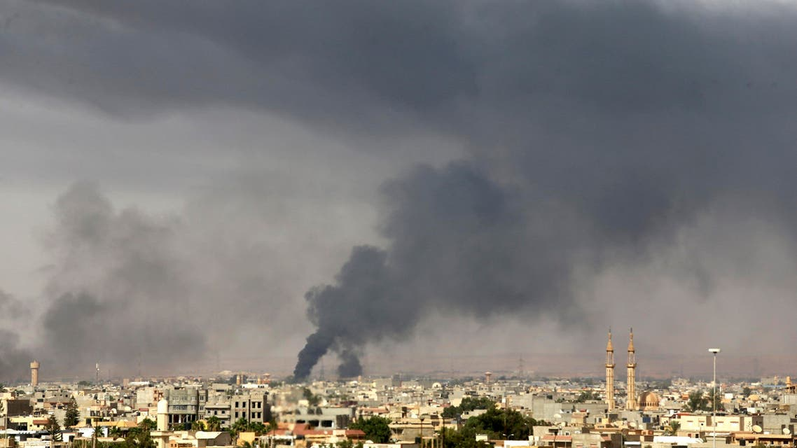 Black plumes of smoke is seen in the vicinity of Camp Thunderbolt, after clashes between militants, former rebel fighters and government forces in Benghazi July 27, 2014.