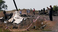 First MH17 crash victims identified