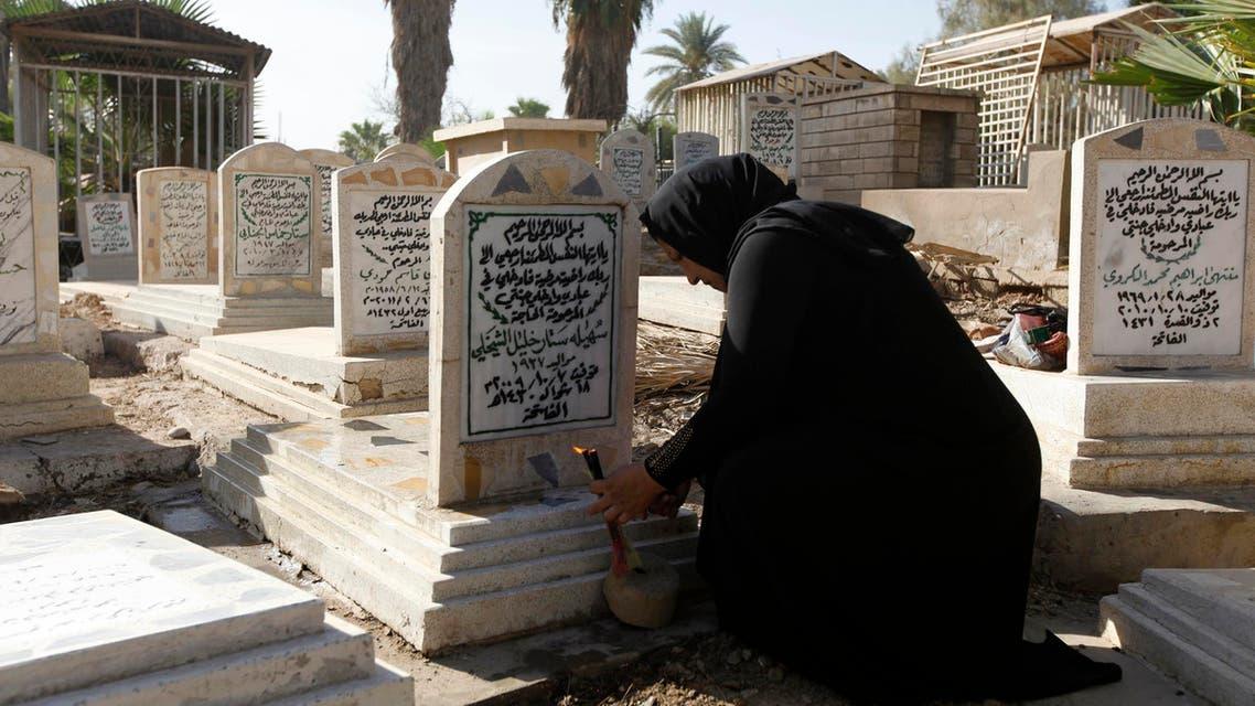 iraqi woman visits cemetery in eid