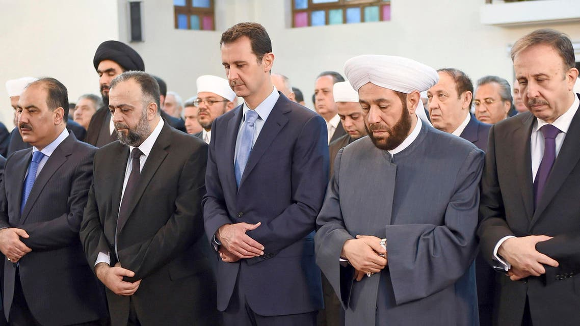 Syria's President Bashar al-Assad (C) attends Eid al-Fitr prayers at al-Khair mosque in Damascus July 28, 2014, in this handout photograph released by Syria's national news agency SANA. Reuters