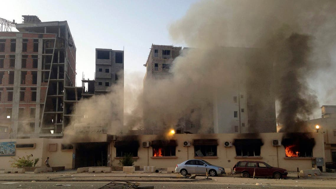 Smoke from a fire at a police station is seen in Benghazi July 6, 2014.