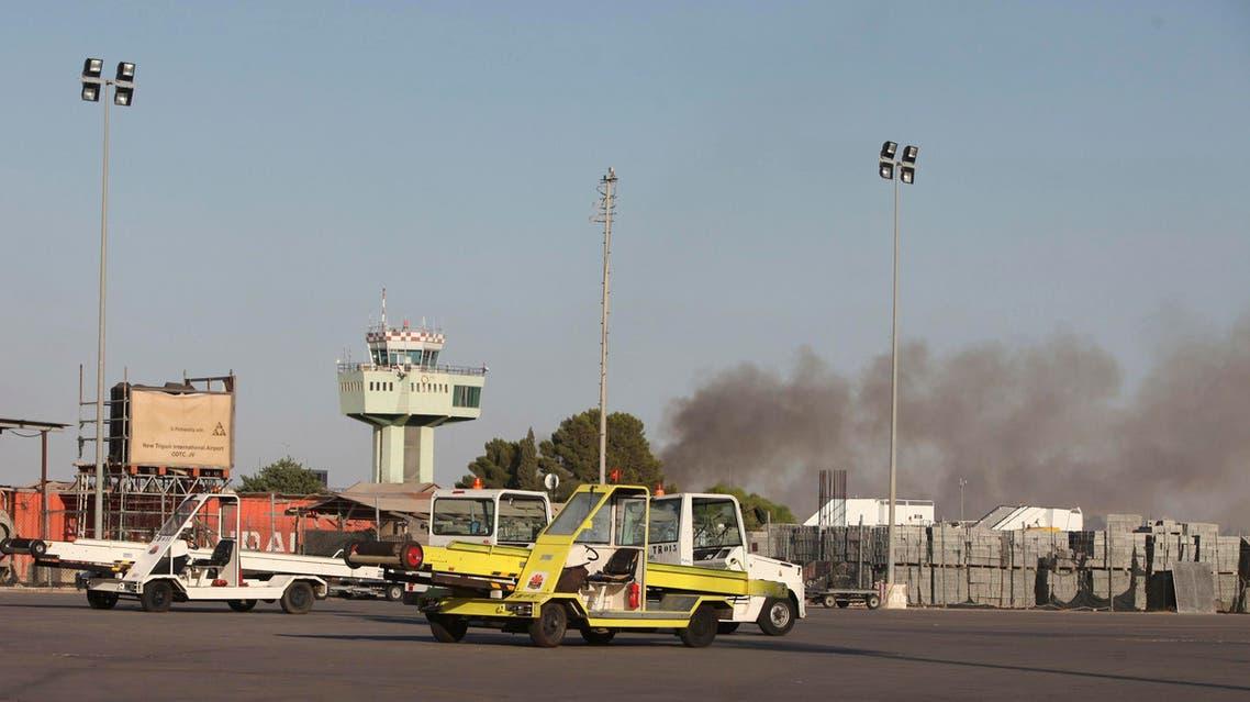 Smoke rises after a shelling at Tripoli International Airport July 15, 2014.