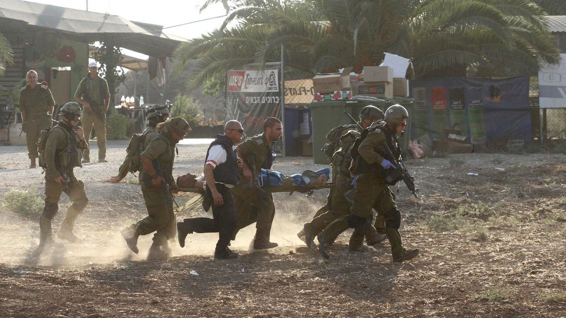 Israeli soldiers carry their comrade on a stretcher after he was wounded in a Palestinian mortar strike, as they evacuate him from the scene outside the central Gaza Strip July 28, 2014. (Reuters)