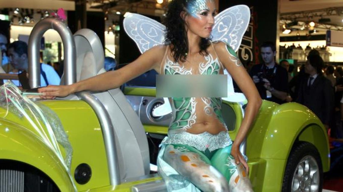A topless body-painted model presents the French-made Acrea Zest on media day at the Paris Mondial de l'Automobile September 28, 2006.