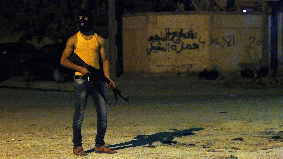 A masked Libyan gunman stands on a street in the eastern city of Benghazi, early on July 29, 2014,