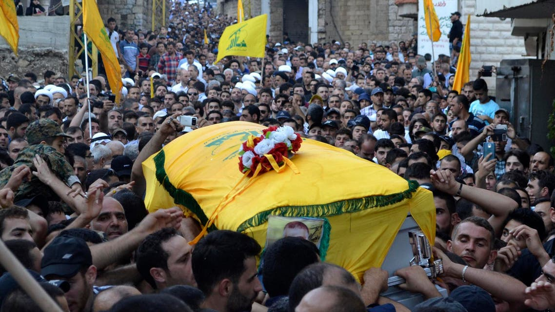 Mourners carry the coffin of Ibrahim al-Haj, a Hezbollah commander who died during a mission in Iraq, during his funeral in Mashghara village in the Bekaa Valley July 30, 2014