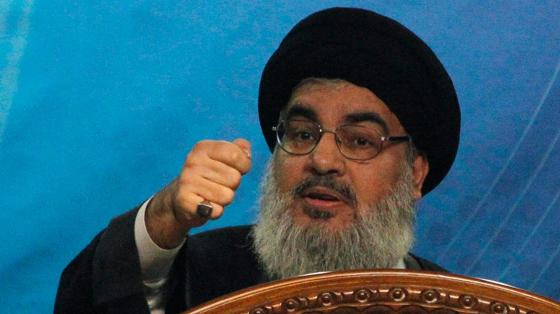 """Lebanon's Hezbollah leader Sayyed Hassan Nasrallah makes a rare public appearance as he addresses his supporters during a rally to mark """"Quds (Jerusalem) Day"""" in Beirut's southern suburbs July 25, 2014."""