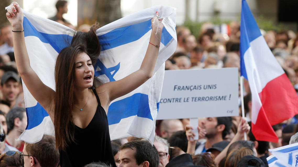 People demonstrate to support Israel's military action in the Gaza strip, near Israel's embassy in Paris, July 31, 2014.
