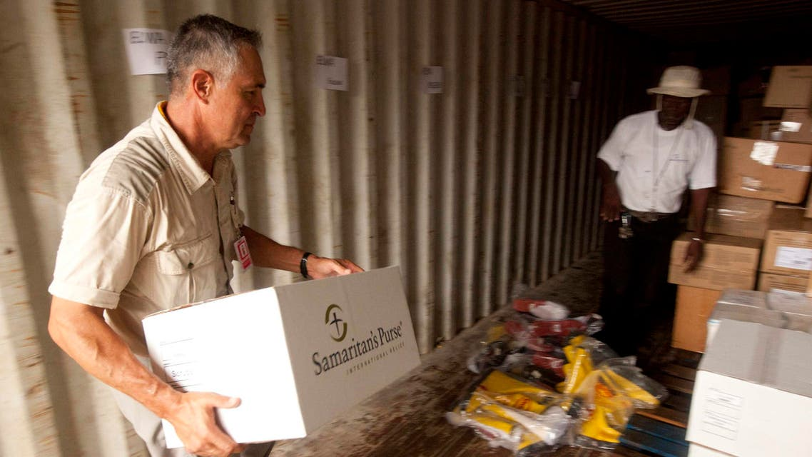 A Samaritan's Purse volunteer helps with supplies in Liberia in this undated handout photo courtesy of Samaritan's Purse. (Reuters)