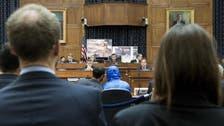 Syria defector in Washington shows torture photos