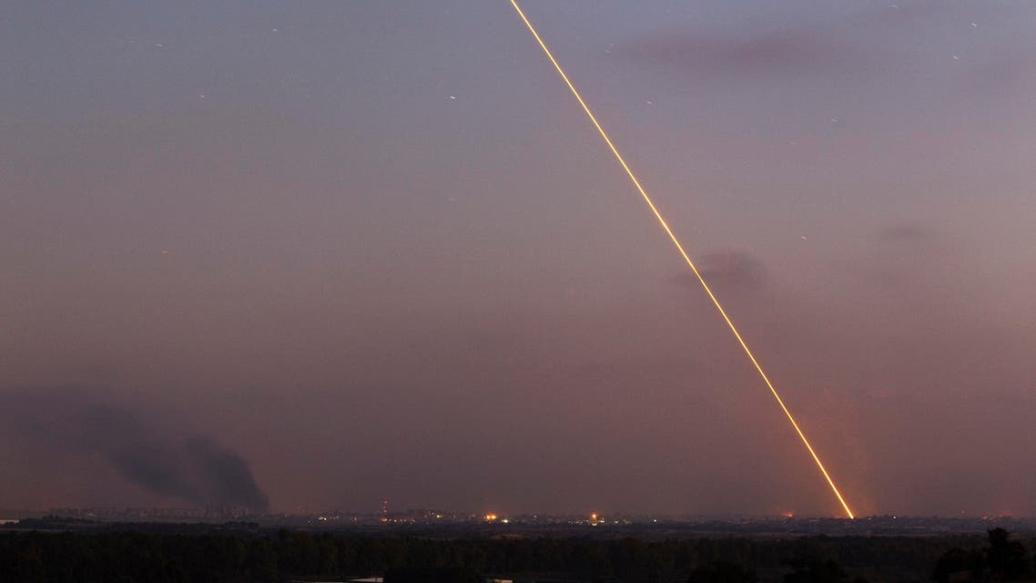 Light streak trail is seen as a rocket is launched from the northern Gaza Strip towards Israel July 29, 2014.  Reuters